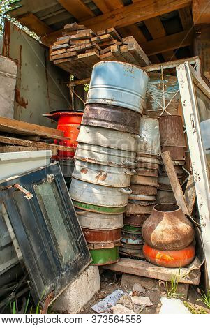 A Pile Of Garbage. Piled In A Heap Of Old, Rusty, Useless Things. Dump On A Farm, Village