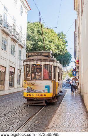Lisbon, Portugal - October 10, 2017: Tram Riding In Alfama District Of Lisbon, Portugal