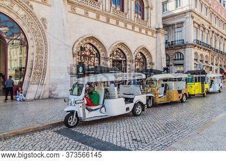 Lisbon, Portugal - October 10, 2017: Tuk Tuks In Front Of Rossio Railway Station In Lisbon, Portugal