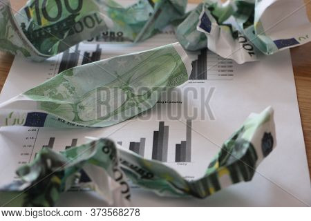 Crumpled 100 Euro Banknotes On Golden Background. Selective Focus. Money Value Currency Inflation Co