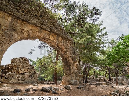 Ruins Of Aqueduct Of Ancient Phaselis City. Famous Architectural Landmark, Kemer District, Antalya P