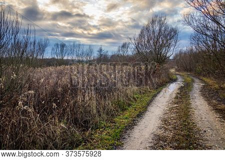 Muddy Dirt Road Under The Stormy Sky
