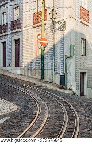 Tram Tracks In Alfama Neighborhood Of Lisbon, Portugal