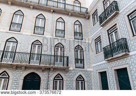 House With Balconies In Alfama Neighborhood Of Lisbon, Portugal