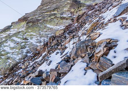 Rocks And Snow At The Slopes Of Coma Pedrosa, Highest Mountain In Andorra