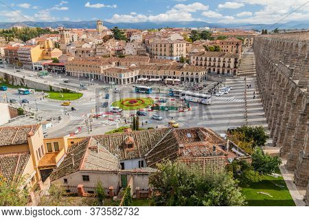 Segovia, Spain - October 20, 2017: Streets And Houses And The Roman Aqueduct In Segovia, Spain