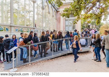Madrid, Spain - October 22, 2017: Tourists In A Line To Palacio De Cristal Glass Palace In Retiro Pa