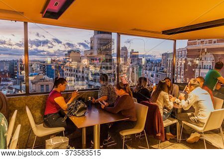 Madrid, Spain - October 22, 2017: People In Bar At El Corte Ingles Building Observing A Sunset In Ma
