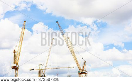 Panorama Of Crane Construction Site On Background Of Blue Sky And Cloud.
