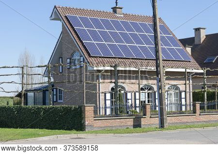Sint Gillis Waas, Belgium,  March 22, 2020, House With Strange Roof Construction And Solar Panels