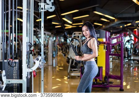 Fitness Asian Women Performing Doing Exercises Training With Rowing Machine (seat Cable Rows Machine