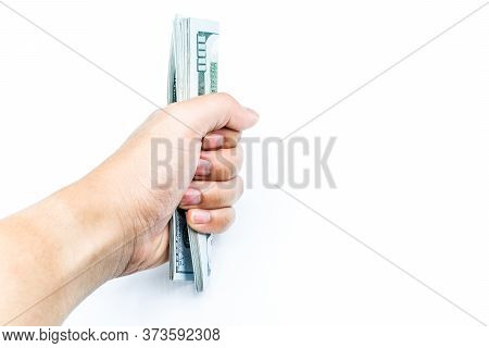 Cropped Shot Of Men Hand Grab A Pile Of One Hundred Dollars On Isolated White Background. The Offici