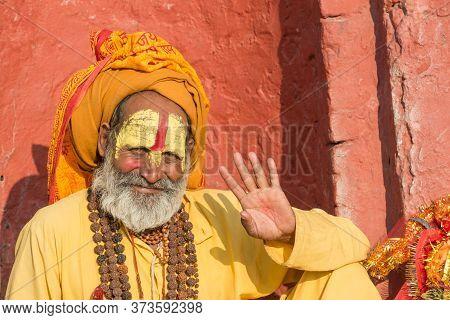 Kathmandu, Nepal : October-18-2018 : Portrait Of Sadhu (yogi Or Holy Man) Greeting To Tourist In Pas