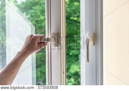 Woman Hand Opens A Plastic Window For Airing. Modern Plastic Windows.