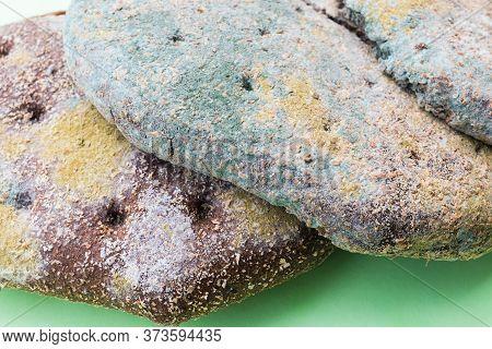 Moldy, Spoiled Bread . Moldy Inedible Food. Closeup