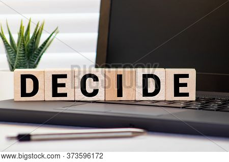 Decide Word Letters Written On Wooden Blocks. Motivational Business Idea Startup Concept.