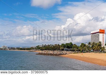 A Seaside Landscape Of A Coastal Suburb With A High Rise Hotel Looking Out Over An Esplanade To The