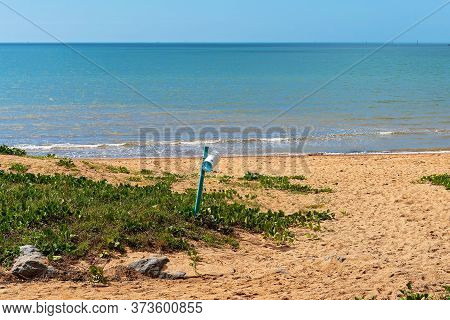 Bottle Of Vinegar Left On The Beach For Public Use In Case Of Stinger Stings