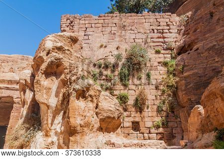 Wall Of A Cistern Next To The Garden Temple In The Ancient City Petra, Jordan