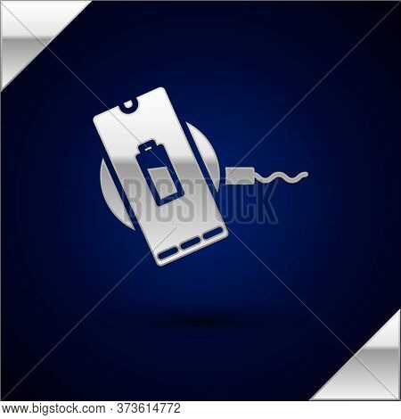 Silver Smartphone Charging On Wireless Charger Icon Isolated On Dark Blue Background. Charging Batte