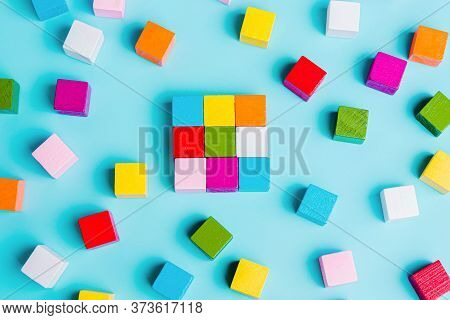 Chaotically Disorganized Colored Cubes And Ordered. The Concept Of Business Model, Structure, Logica