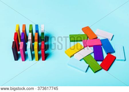 Order And Chaos. Chaotic Unorganized Colored Dominoes And Ordered. Concept Of Business Model