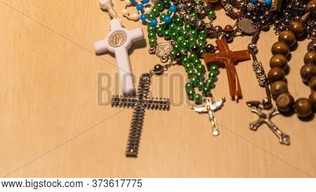 Crucifixes On Light Background. They Represent The Cross Of Christ, A Symbol Of Veneration Of The Sa