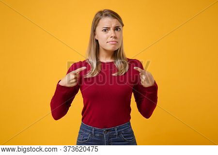 Perplexed Young Blonde Woman Girl In Casual Clothes Posing Isolated On Yellow Orange Wall Background