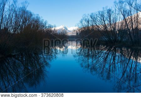 Winter Mountain Landscape With Clear Water Lake Snow-capped Mountains Reflection. Glenorchy Lagoon,