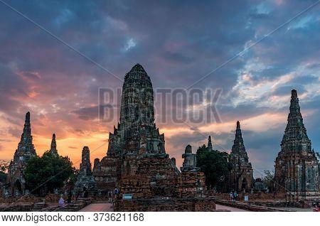 Ayutthaya, Thailand - December 30, 2015: Tourists Visiting Old Temple Ruins On Sunset. Wat Chai Watt