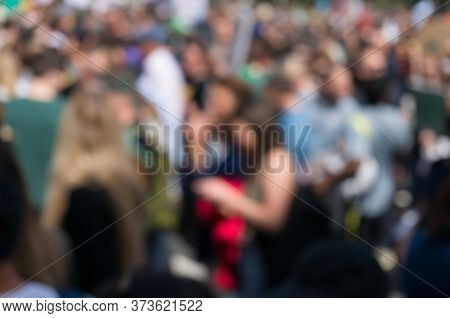 Crowd Of People Blurred Background. Unidentifiable, Anonymous People In The Crowd Abstract City Back