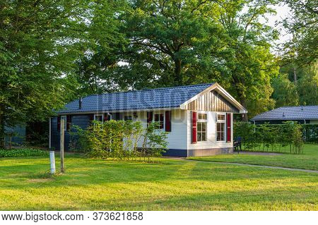 Landscape With Colorful Wooden Vacation Home At Recreation Park In The Middel Of Nature In The Nethe