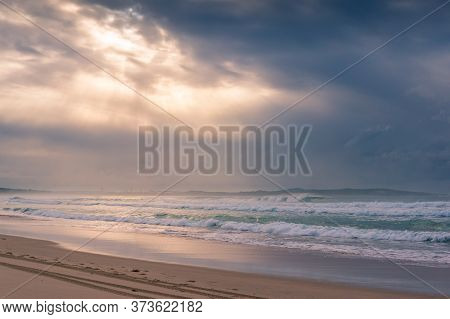 Beach Sunrise Landscape With Soft Waves And Beautiful Sunlight. Summer Beach Holiday