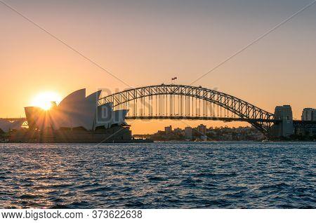 Sydney, Australia - May 27, 2016: Iconic Sydney Opera House And Sydney Harbour Bridge On Sunset