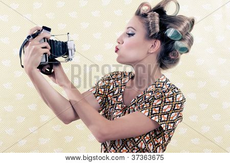 Woman taking self-portrait  from vintage 4x6 film camera .