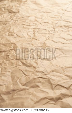Crumpled Brown Creased Paper. Old Wrapping Dusty Paper. Delivery Concept. Selective Focus. Vertical