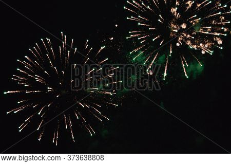 Pyrotechnic Composition Of A Golden Glow In The Sky Against A Background Of Emerald Haze From Previo