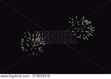 The Green Pyrotechnic Volley In The Night Sky Is Very Beautiful And Causes Delight.