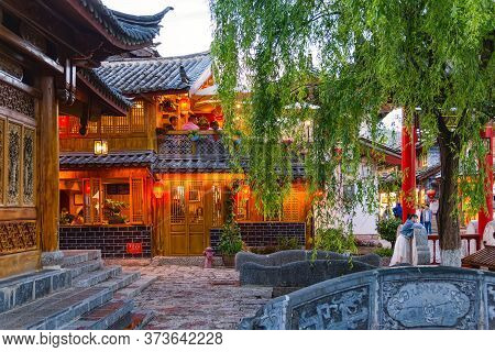 Lijiang, China - April 26, 2019: View Of The Old Town With Chinese Tourist. Old Town Is An Unesco Wo