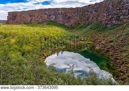The Little Botnstjorn Lake In Asbyrgi Canyon, Iceland. Asbyrgi Is A Glacial Canyon In The North Of I