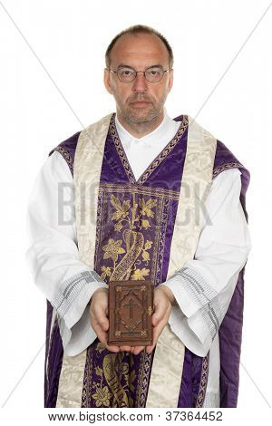 a catholic priest with a bible in worship