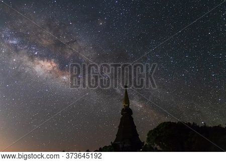 Milky Way Galaxy With Stars On Night Sky ; Silhouette Of The Great Holy Relics Pagoda At Doi Inthano