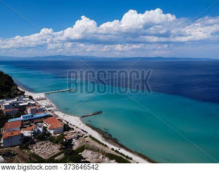 Chalkidiki, Greece Coastal Village Landscape Drone Shot With Seaside Hotel. Aerial Day View Of Kalli