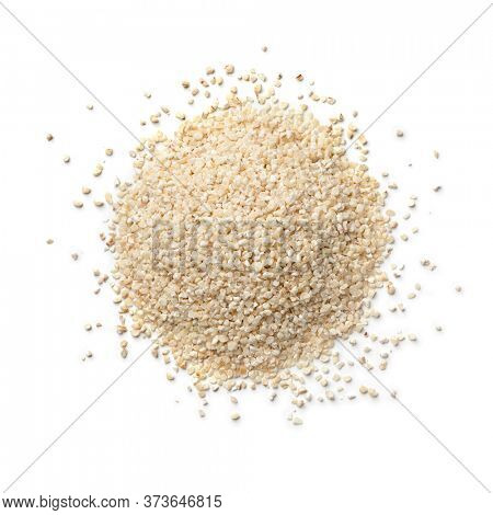 Heap of traditional  Moroccan belboula, barley grits isolated on white background