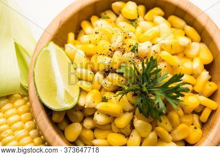 Spicy Masala Sweet Corn Is A Tasty Roadside Indian Snack, Which Is Very Easy To Make. Selective Focu