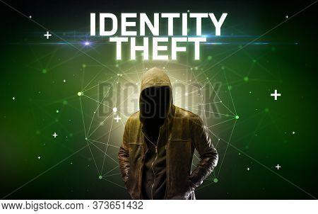 Mysterious hacker with IDENTITY THEFT inscription, online attack concept inscription, online security concept