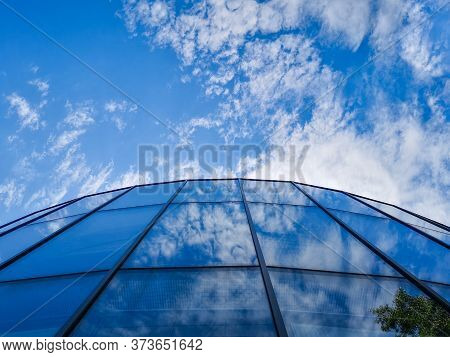 Zielona Gora Poland 8 June 2019 Upward Look To Glass Building And Reflections Of Clouds And Tree