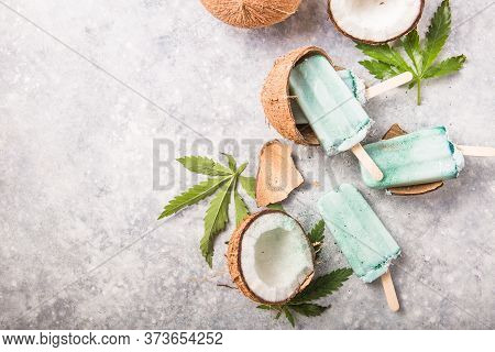 Ice Cream Popsicle Bars With Coconut Slices, Cannabis On Concrete Background.hemp Ice Cream Popsicle