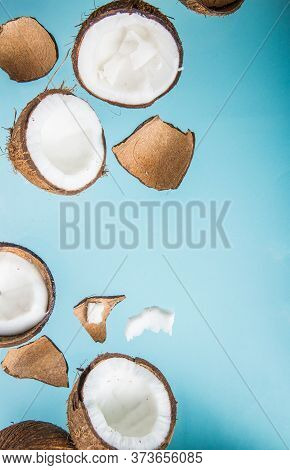Halves Of Coconut, Open  Cut In Half Isolated On Blue Background. Coconut Pulp Is Very Healthy Whole