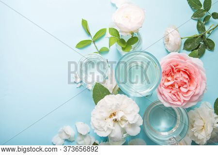 Spring Fresh White, Pink Roses Distorted Through Liquid Water Of  Glass On Blue.rose Flower Backgrou